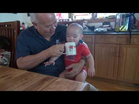 Baby drinks coffee