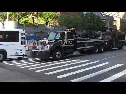 GIANT NYPD WRECKER TOWING A UPS TRUCK ON WEST 42ND STREET IN HELL'S KITCHEN, MANHATTAN, NEW YORK.