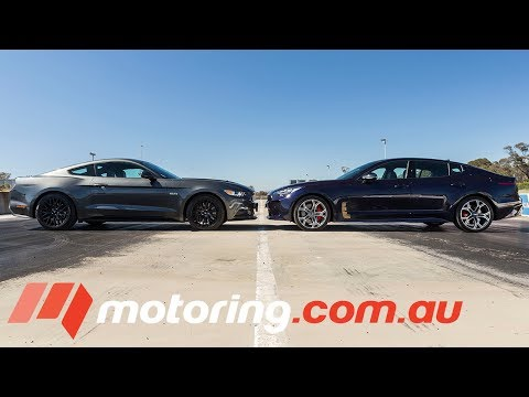 Watch The Kia Stinger Gt Outrun A Mustang Gt Wide Open Roads
