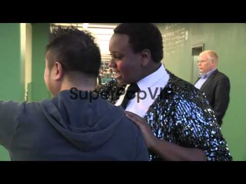 Alex Newell greets a fan while arriving at the Twilight B...