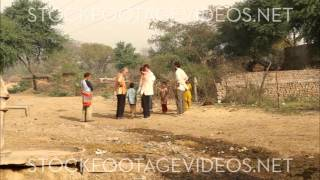 group of men talking in small villiage, India