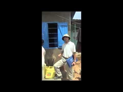 WaterCan in Uganda:George Yap at Water Kiosk in Kampala Slums