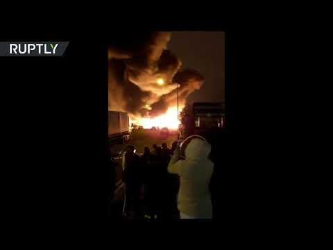 Huge fire engulfs paint factory in London