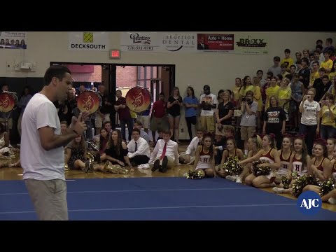 VIDEO: Teacher Proposes to Girlfriend at Lassiter High School pep rally