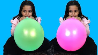 Shfa learns colors with balloons !