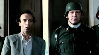 Roberto benigni translates german rules to make his son believe everything's just a game.