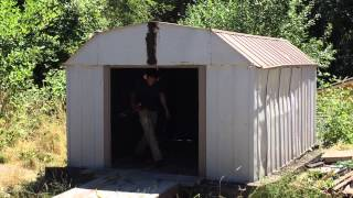 Demolition 101: Taking top off old, tin can shed.