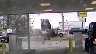 SUV speeds from bank drive-thru and flies over car
