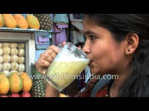 Fresh Fruit juice shop in a Delhi market - pineapple and sweet lime