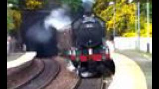 Steam Train Erupting From A Tunnel