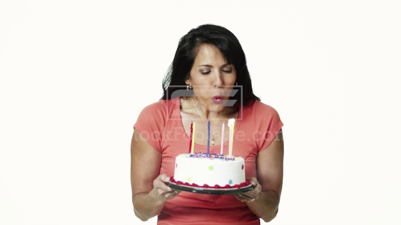 Woman Blowing Out Candles On Birthday Cake Youtube