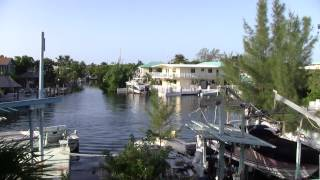 KEYS DIVER 3 & OTHER BIG BOATS LEAVING KEY LARGO CANALS + LIVING IN THE FL KEYS + DEAD OBAMA BUGS