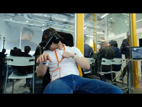 VR conference visitor tests virtual reality helmet