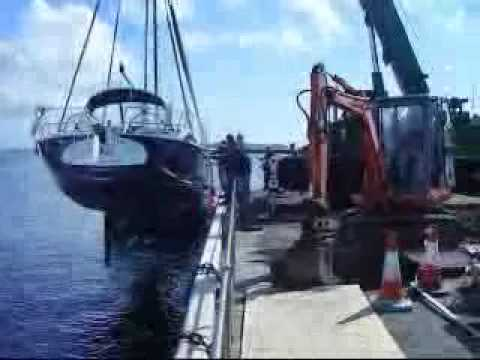 crane lifting yacht in guernsey