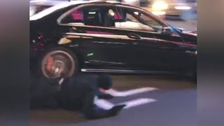 Dramatic Video Shows Cop Getting Hit By Driver, Then Chasing Car on Foot thumbnail