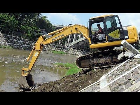 Komatsu PC130F Excavator Climbing Down Slope and River Dam