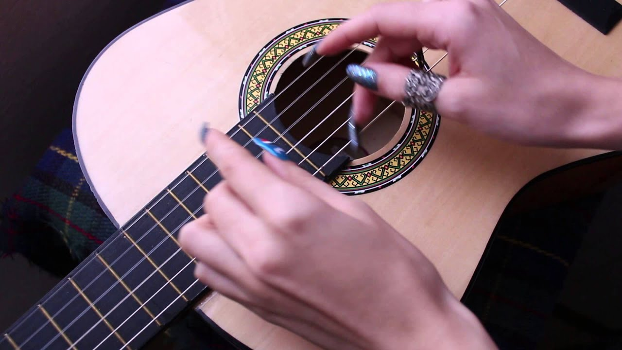 playing guitar with long nail