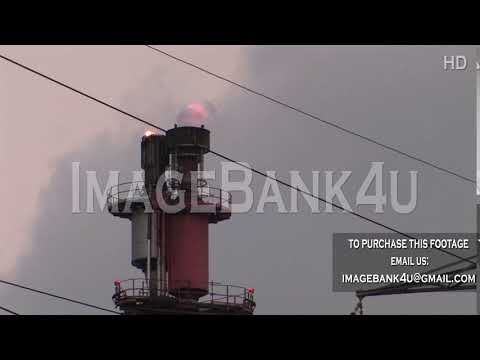 Chimneys with fire and smoke in Petroleum plant