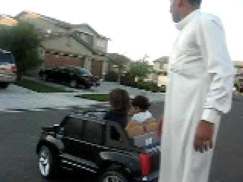 yemni kid driveing cadillac in street of cali