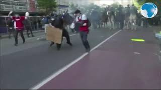 Peaceful protesters tear-gassed to clear the way for Trump's photo opportunity