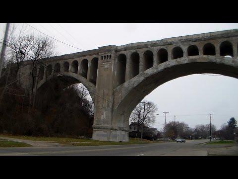 a worker buried in a train bridge pillar