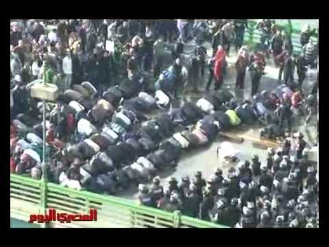 RAW FOOTAGE of praying protesters being attacked  Egypt Protest Riot Revolution 2011