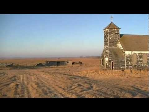 Abandoned church and old house at Arena, North Dakota