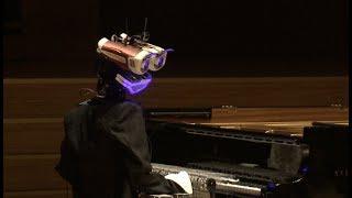 Gambar cover Robot VS Human: Pianist Battle Debuts in Beijing