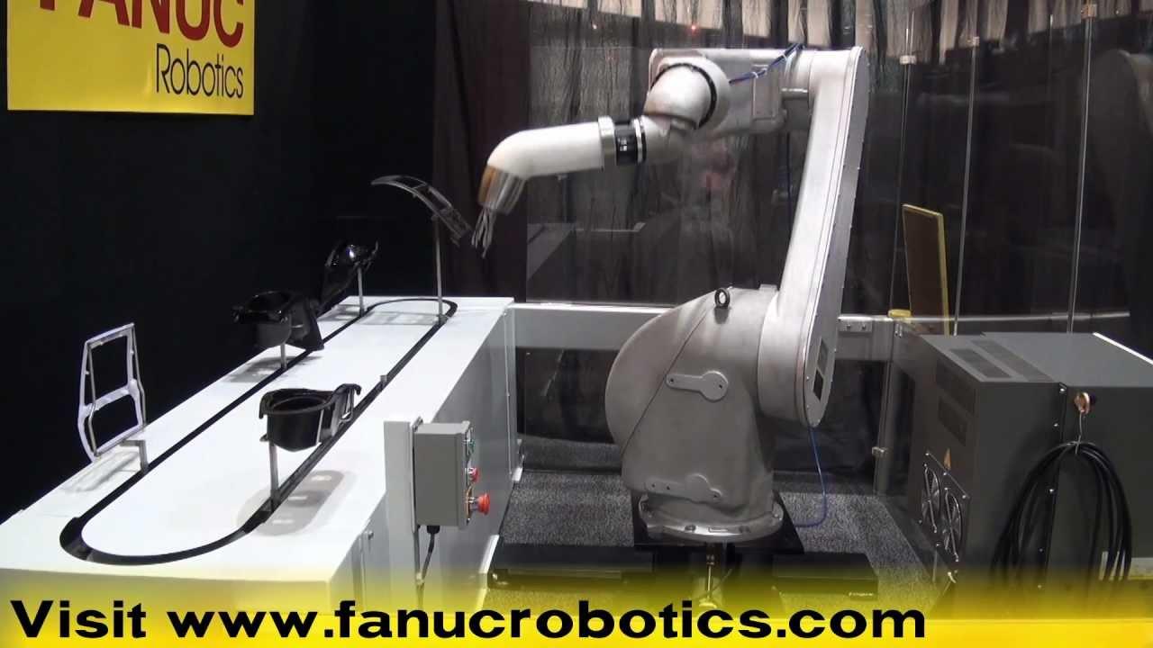 FANUC Robotics New P-50iB Paint Robot Paints Parts in Chain-on ...