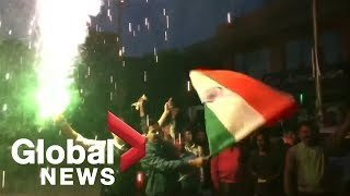 People in India celebrate return of pilot captured by Pakistan