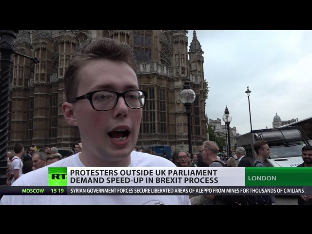 UK activists rally outside Parliament urging speedup of Brexit