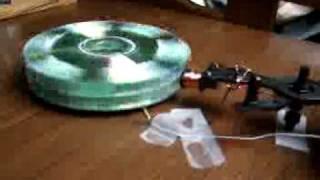 Bedini SSG Experiments 001 - Junk slim drive & CD-R x 3