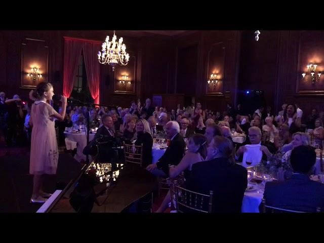 Karolina Protsenko is playing violin on Fundraising of Operation Walk at California Club