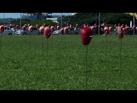 Hundreds of red masks displayed against Brazil corruption