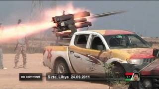 Libyan fighters fire mortars against pro-Gaddafi positions in Sirte - no comment