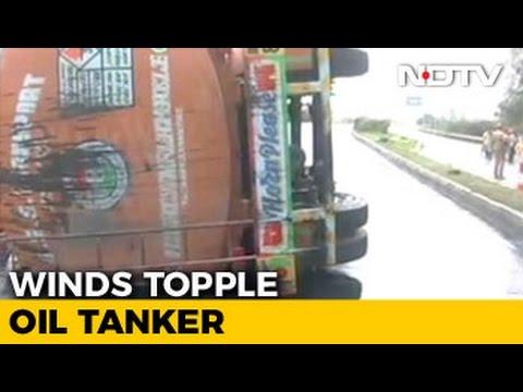 Cyclone Vardha Topples Tanker in Andhra Pradesh