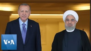Turkey's President Erdogan Greets Iran's President Rouhani for Syria Summit