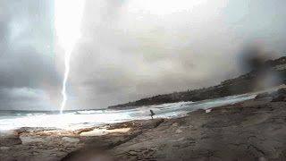 Lightning almost strikes girl in Sydney!!! Boyfriend's reaction is priceless!!!!