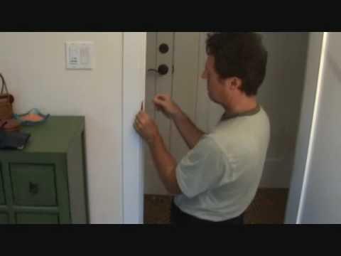 Adjusting a strike plate on a rattling door