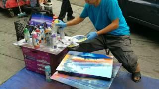Spray paint artist behind city hall.