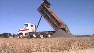Dump truck dumping rock