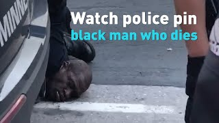 Watch as this white a police officer pins an unarmed black man who later dies