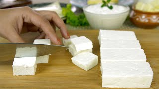 Closeup shot of woman hands cutting fresh paneer on a wooden chopping board