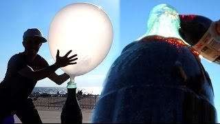 100 Layers of Pop Rocks in Soda Inflates Giant Balloon!