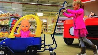 Shopping with Funny baby doll at the Supermarket