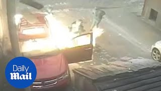 Arsonists setting fire to car nearly blow THEMSELVES up