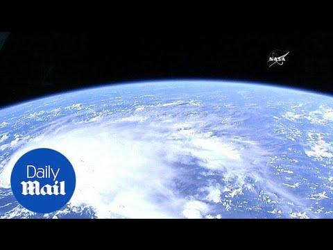 NASA shows Hurricane Matthew as it hits Haiti's southern tip - Daily Mail