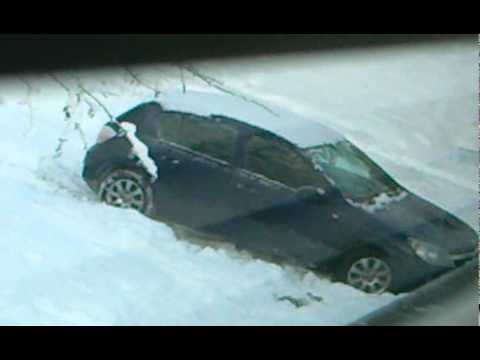 Woman driver stuck in snow - funny