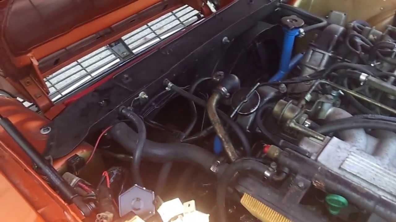 Testing oil pressure with manual gauge, V12 Jaguar, 1982 ...