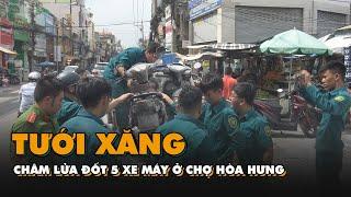 Người đàn ông tưới xăng châm lửa đốt 5 xe máy ở chợ Hòa Hưng